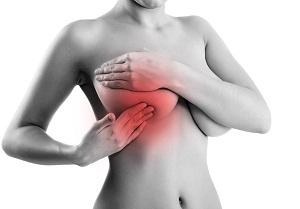 Почему набухает и болит грудь в середине цикла